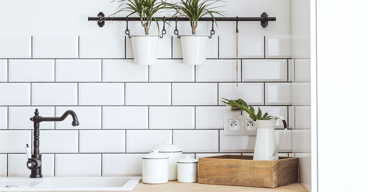 White subway tile with gray grout in a kitchen.