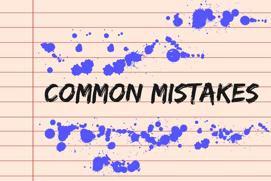 Common mistakes concept on lined paper