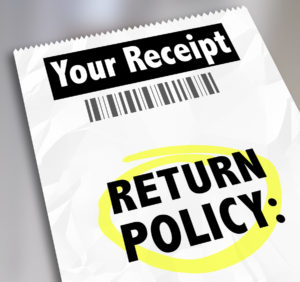 Return Policy words on a store receipt or proof of purchase to t