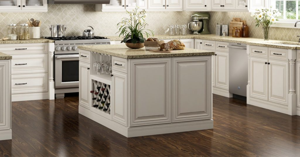 Square kitchen island with wine rack on one side.