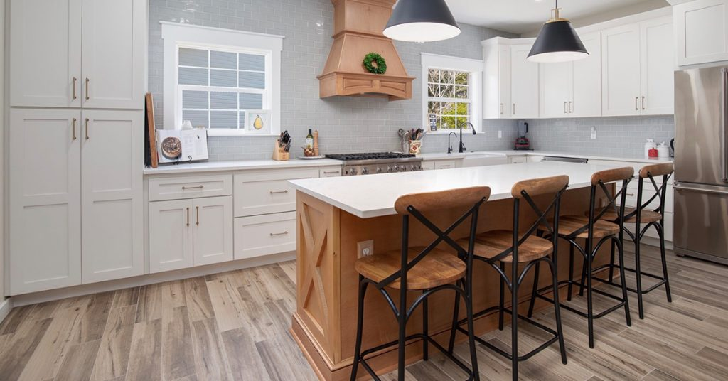 Kitchen with wood island and white countertop.