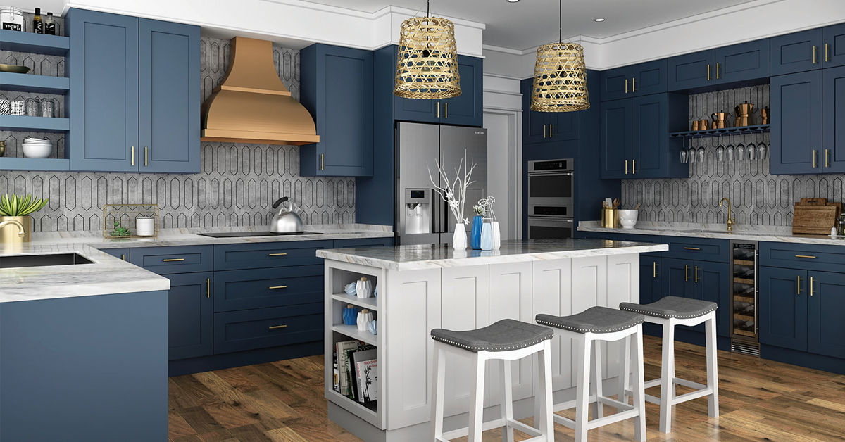Kitchen with blue cabinets, marble countertops, and small gray island.