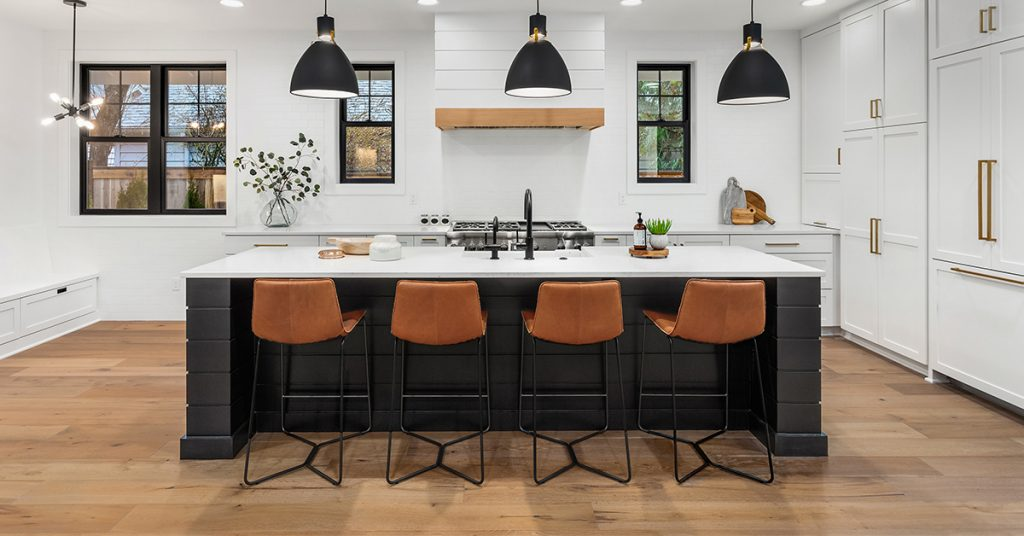 White kitchen with high-contrast black island and accessories.