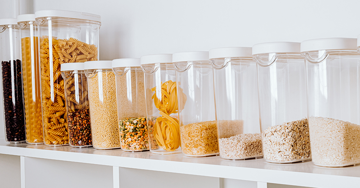 Clear plastic storage containers on a shelf in the pantry help you keep your kitchen organized.