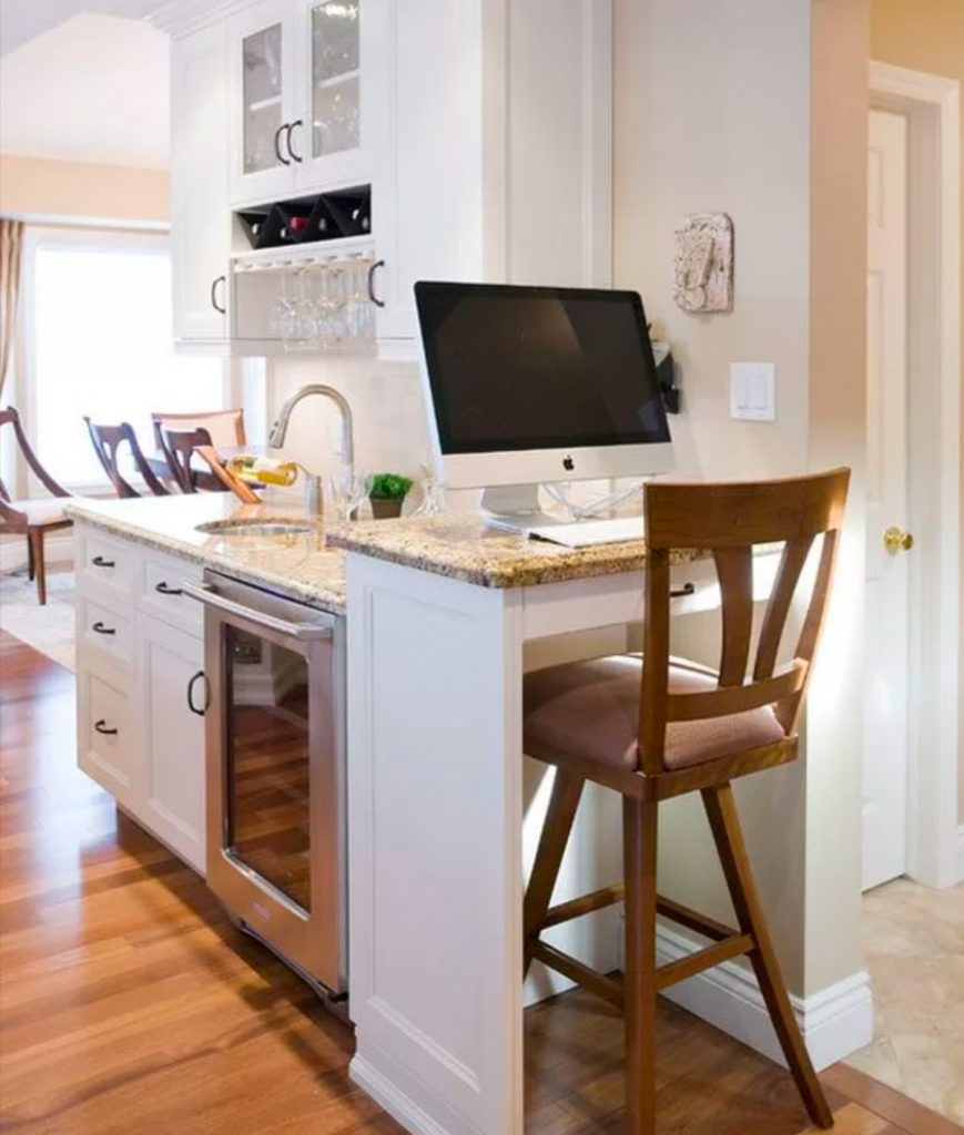 Work station in a transitional kitchen makes this kitchen ultra functional.