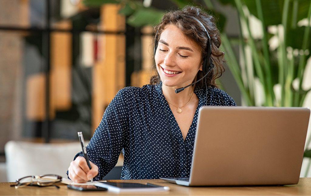 Customer service representative working on a laptop.