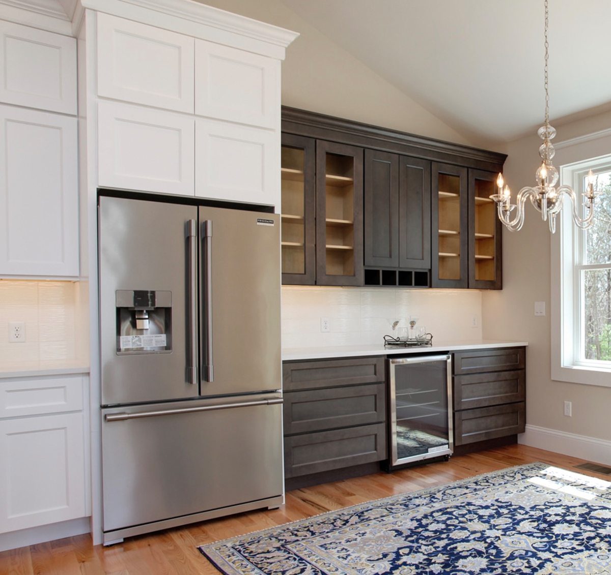 Large open kitchen with two toned cabinets.