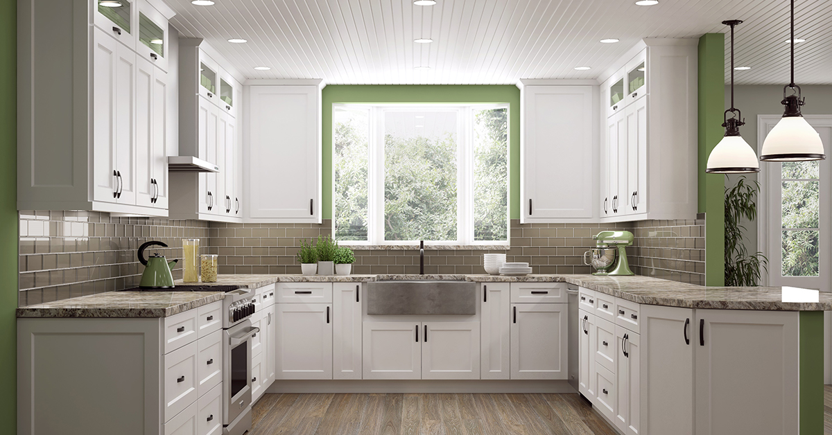 U-shaped kitchen with white cabinets and green accents.