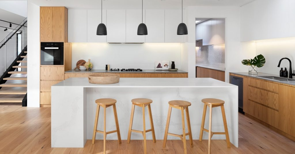 Flat panel cabinets like those in this white kitchen are popular in Europe.