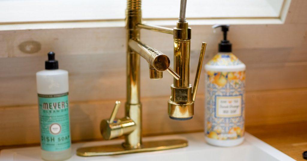 Gold kitchen faucet in a modern kitchen.