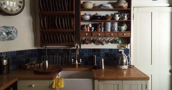 Out of date kitchen design with short backsplash.