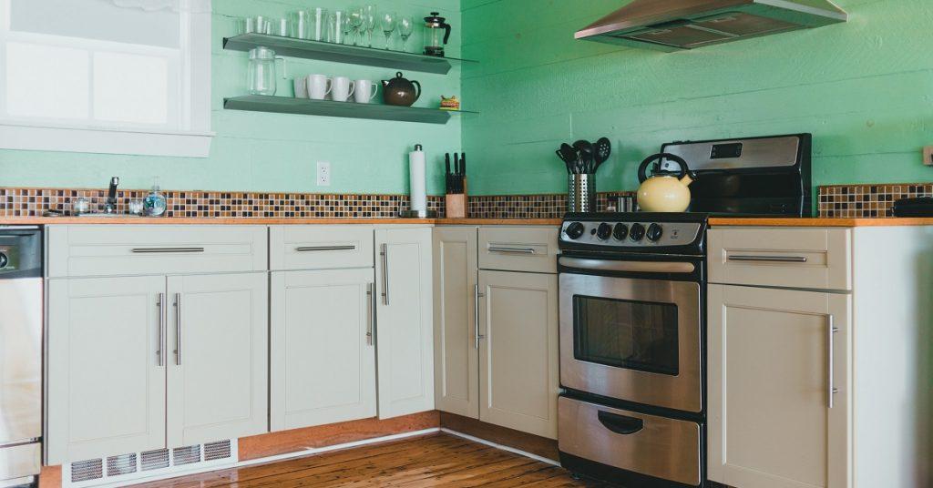 Kitchen with green tile on the backsplash.