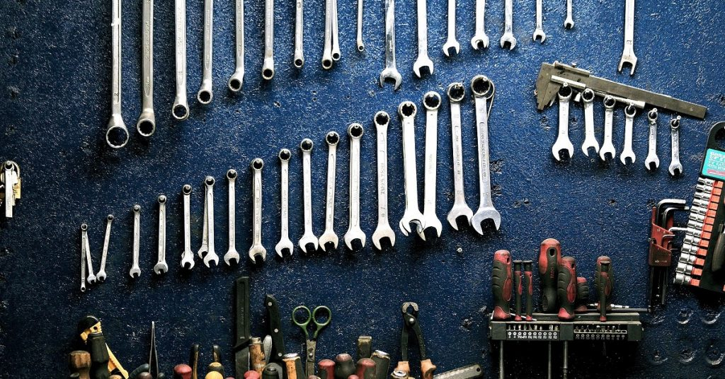 Wrenches on a garage wall.