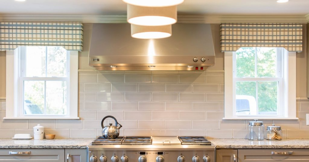 Cozy kitchen with fabric valances.